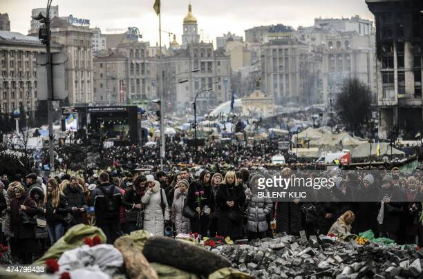 People visit and mourn on Kiev's Independence Square on February 25 2014 Ukraine's interim leader on February 25 delayed the appointment of a new...