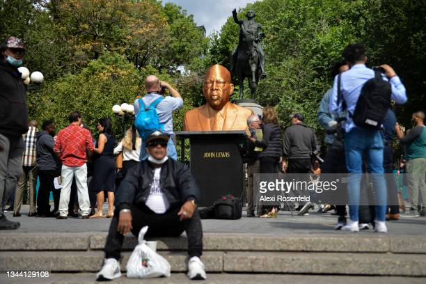 """People visit artist Chris Carnabuci, """"Floyd"""", """"Breonna Taylor"""", and """"John Lewis"""" during Confront Art's First Exhibition SEEINJUSTICEin Union Square..."""