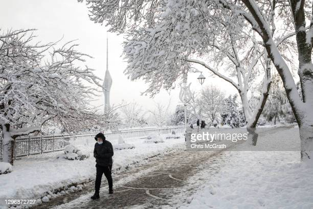 People visit Camlica Hill Park after a snowstorm during the weekend coronavirus lockdown on January 17, 2021 in Istanbul, Turkey. Turkey continues to...