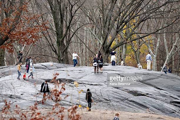 People visit Central Park on a warm day on December 24 2015 in New York City New York City has seen highs in the upper 50s this week with...