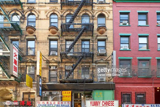 new york, usa - september 9, 2017: people visit chinatown in new york. nyc chinatown has an estimated population of 100,000 people and is one of oldest chinatowns outside asia. - chinatown stock pictures, royalty-free photos & images