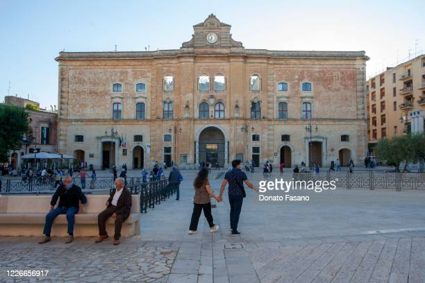 People visit CineTeatro Comunale Gerardo Guerrieri on May 23 2020 in Matera Italy Restaurants bars cafes hairdressers and other shops have reopened...