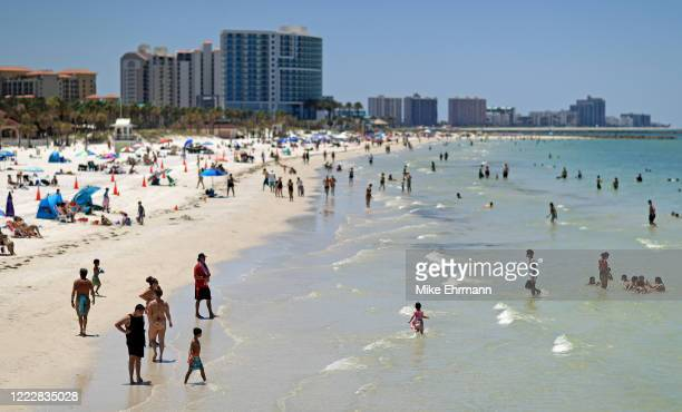 People visit Clearwater Beach after Governor Ron DeSantis opened the beaches at 7am on May 04, 2020 in Clearwater, Florida. Restaurants, retailers,...