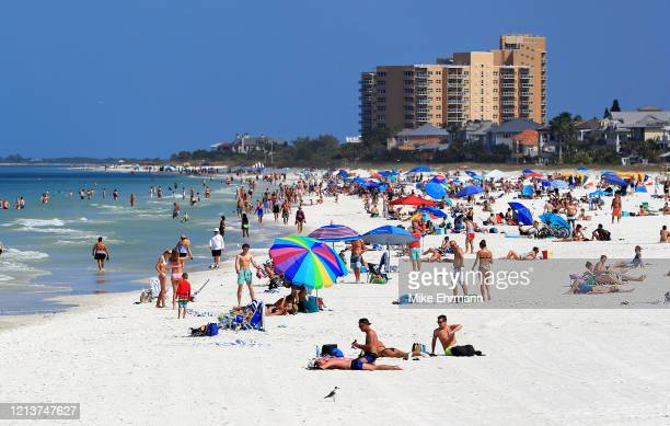 People visit Clearwater Beach during the coronavirus pandemic March 20, 2020 in Clearwater, Florida. The World Health Organization declared COVID-19...