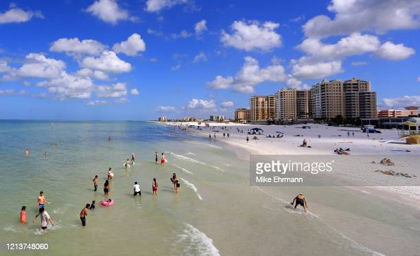 People visit Clearwater Beach during the coronavirus pandemic March 20 2020 in Clearwater Florida The World Health Organization declared COVID19 a...