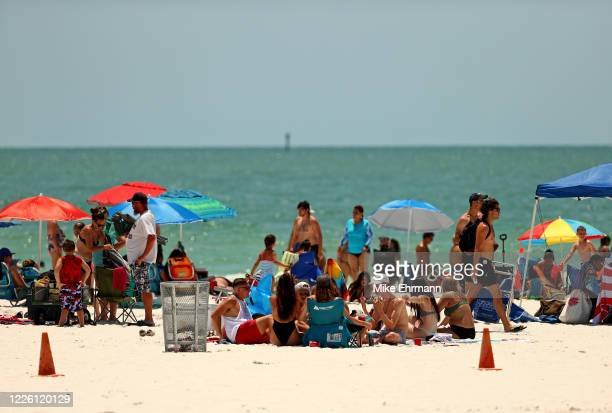 People visit Clearwater Beach on May 20 2020 in Clearwater Florida Florida opened its beaches as part of Phase 1 its reopening as Governor Ron...