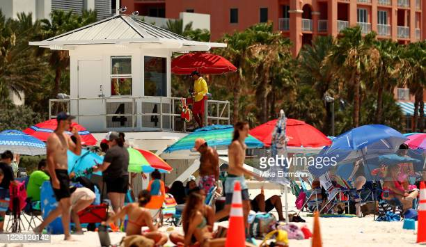 People visit Clearwater Beach on May 20, 2020 in Clearwater, Florida. Florida opened its beaches as part of Phase 1 its reopening, as Governor Ron...