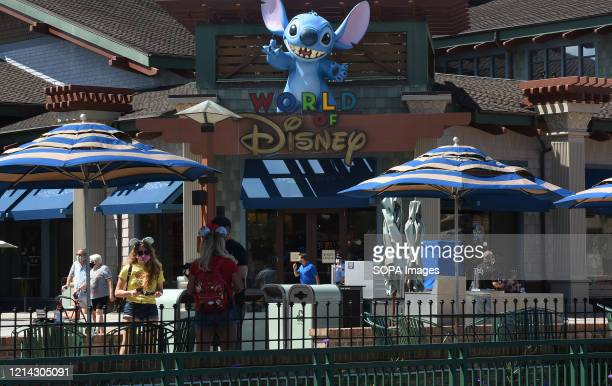People visit Disney Springs at Walt Disney World on the day the retail dining and entertainment complex begins a phased reopening following the...