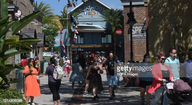 People visit Disney Springs at Walt Disney World on the day the retail, dining, and entertainment complex begins a phased reopening following the...