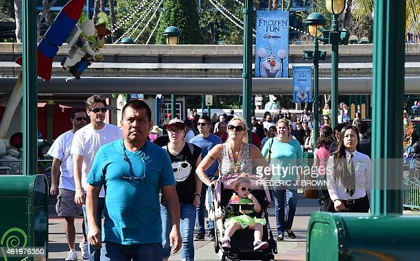 People visit Disneyland on January 22 2015 in Anaheim California The theme park known as The Happiest Place on Earth for spreading happiness has a...