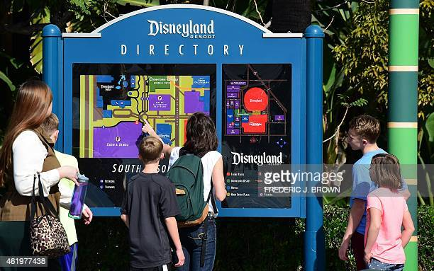 People visit Disneyland on January 22 2015 in Anaheim California The theme park known as 'The Happiest Place on Earth' for spreading happiness has a...