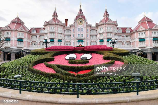 People visit Disneyland Paris, in France on March 9, 2020. A first case of Covid-19 was confirmed Sunday evening among the 17,000 employees of the...