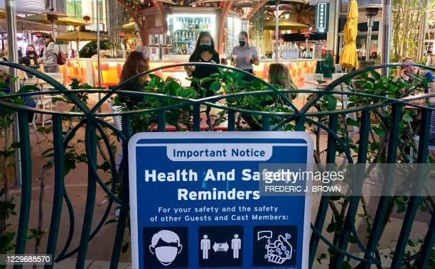People visit Disneyland where parts of the park opened today for more retail and dining as an extension of the Downtown Disney District in Anaheim,...