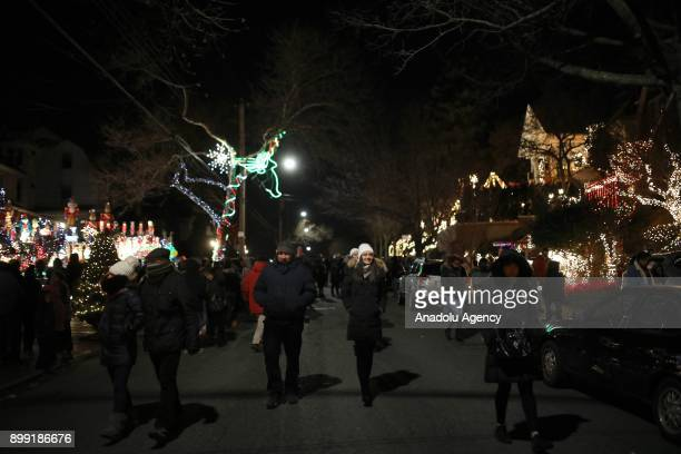 People visit Dyker Heights neighborhood as Christmas lights and other ornaments illuminate the streets in Brooklyn borough of New York United States...