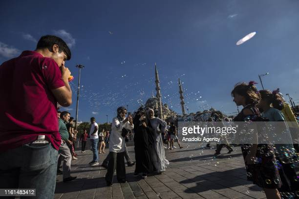 People visit Eminonu Karakoy and historical peninsula during the third day of Eid AlAdha in Istanbul Turkey on August 13 2019 Muslims worldwide...