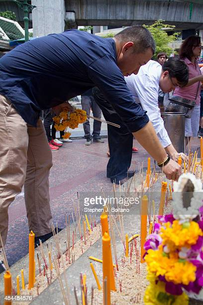 People visit Erawan Shrine after it reopened two days after a bomb exploded close to the shrine in the center of Thailand's capital, Bangkok, killing...