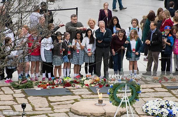 People visit former US President John F Kennedy's gravesite at Arlington National Cemetery Nov 22 2013 in Arlington VA Photo Ken Cedeno