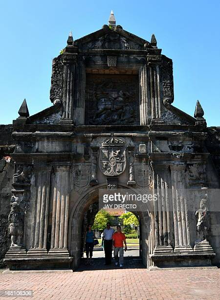 People visit Fort Santiago through the main gate of the fortress in Manila on February 4 2010 Fort Santiago is a defense fortress built for Spanish...
