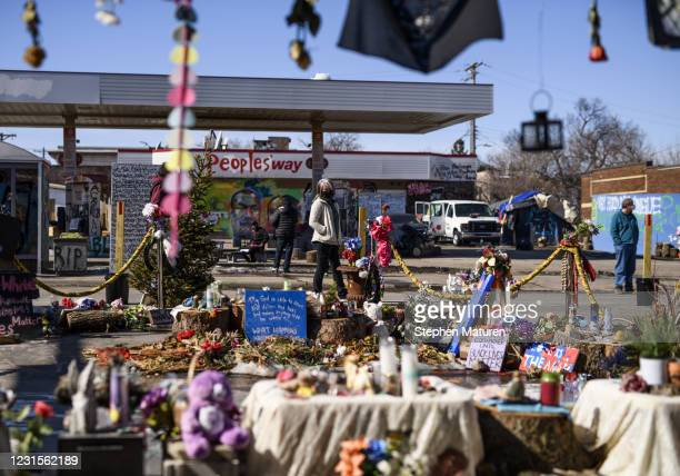 People visit George Floyd Square, the memorial created around the site where he was killed last May, on March 6, 2021 in Minneapolis, Minnesota. Jury...