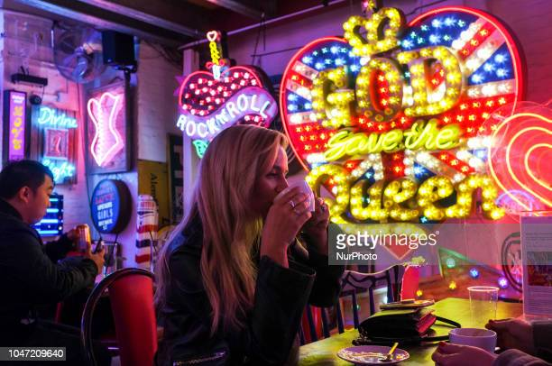 People visit God's Own Junkyard the largest neon stock in Europe in east London on October 7 2018 Gods Own Junkyard is a psychedelic paradise of neon...