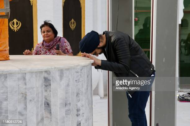 People visit Gurdwara Darbar Sahib Kartarpur shrine where the Sikhism founder Guru Nanak Dev died in Kartarpur town of Punjab province Pakistan on...