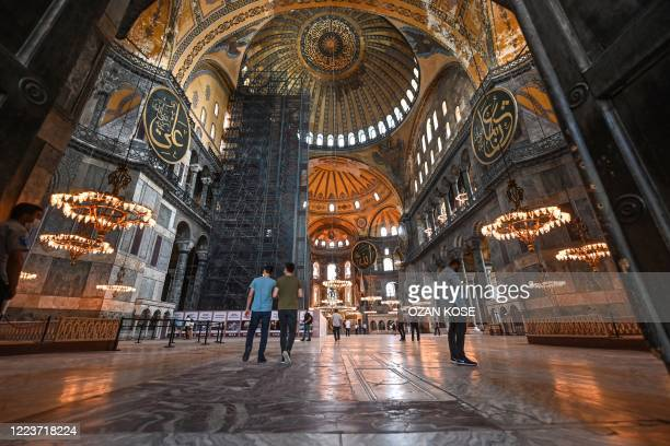 People visit Hagia Sophia museum on June 26, 2020 in Istanbul. - Turkey's top court is due on July 2, 2020 to deliver a critical verdict on the...