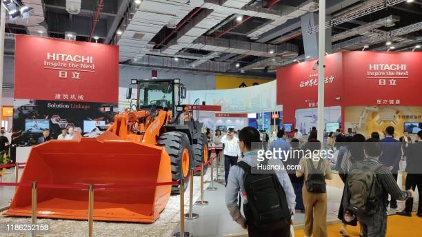 People visit Hitachi booth on day three of the 2nd China International Import Expo at the National Exhibition and Convention Center on November 7,...