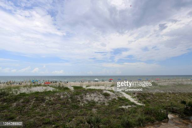 People visit Jacksonville Beach on July 04, 2020 in Jacksonville Beach, Florida. Jacksonville Beach Mayor Charlie Latham said that Duval County...