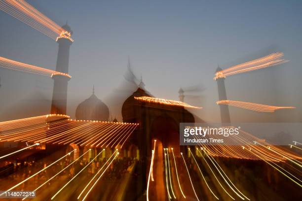 People visit Jama Masjid on the eve of EidulFitr on June 4 2019 in New Delhi India With the sighting of the crescent moon the monthlong Ramadan fast...