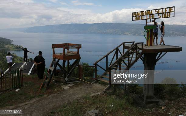 People visit Lake Toba in Parapat, Simalungun District, North Sumatra, Indonesia on July 21, 2020. Lake Toba has become one of the super priority...