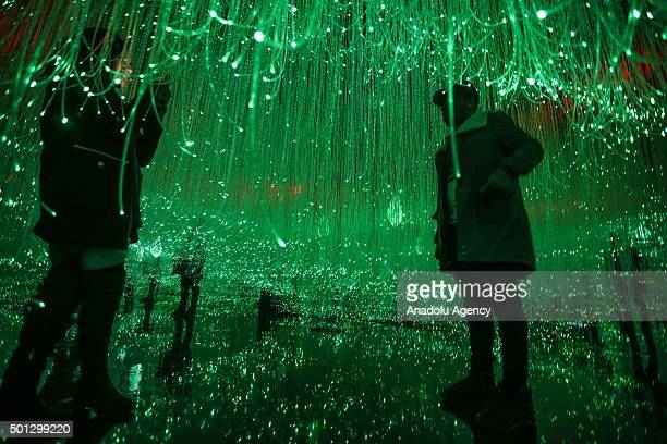 People visit light and color performance called 'Museum of Feelings' comprised of 5 different rooms with 5 different colors representing 'optimism'...