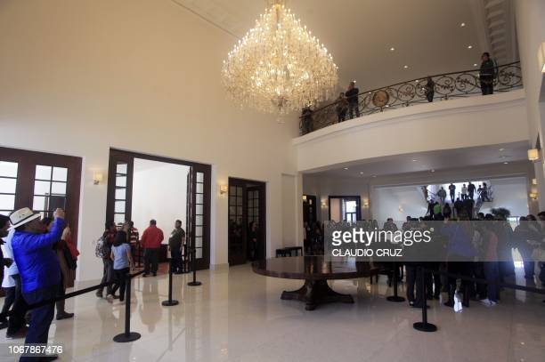 People visit Los Pinos presidential residence in Mexico City, on December 2, 2018 after Mexico's newly inaugurated president Andres Manuel Lopez...