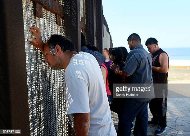 People visit loved ones by communicating through the USMexico border fence at Friendship Park in San Ysidro CA on Sunday April 6 2014 Many deported...