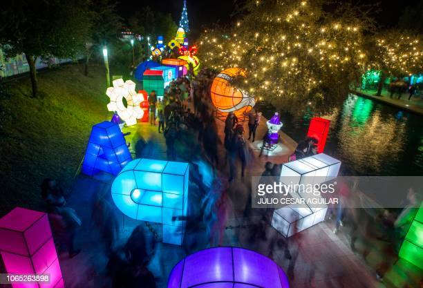 "People visit ""Luztopia"", a festival of lights and Christmas figures exhibited in the Paseo Santa Lucia at the beginning of the holiday season, in..."