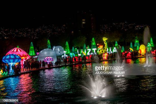People visit Luztopia a festival of lights and Christmas figures exhibited in the Paseo Santa Lucia at the beginning of the holiday season in...