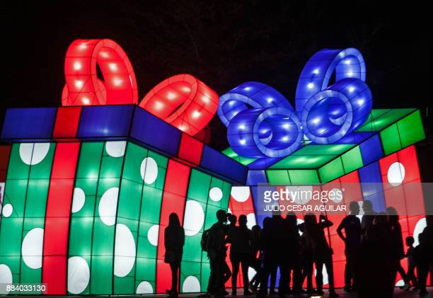"People visit ""Luztopia,"" a festival of lights and Christmas figures exhibited in the Paseo Santa Lucia at the beginning of the holiday season, in..."