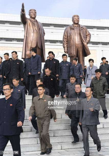 People visit Mansu Hill in Pyongyang where giant bronze statues of late North Korean leaders Kim Il Sung and Kim Jong Il stand on Oct 10 the 73rd...
