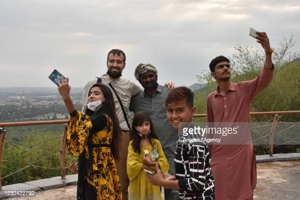 People visit Margalla Hills National Park at Daman-e Koh hill station in Islamabad, Pakistan on April 16, 2021.