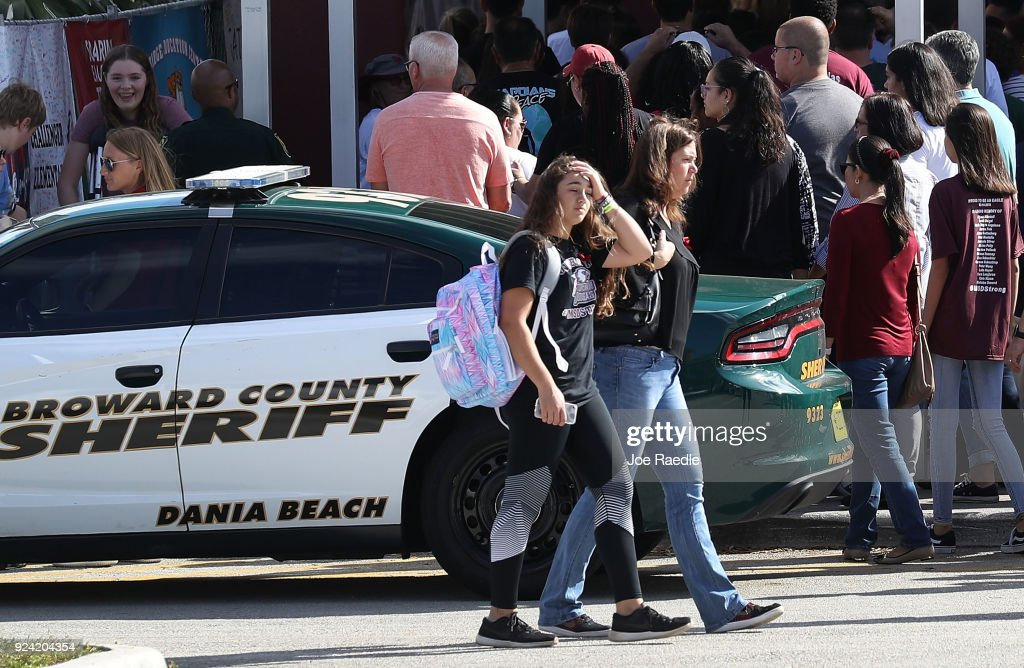 People visit Marjory Stoneman Douglas High School on February 25, 2018 in Parkland, Florida. Today, students and parents were allowed on campus for the first time since the shooting that killed 17 people on February 14. Police arrested 19-year-old former student Nikolas Cruz for the 17 murders.