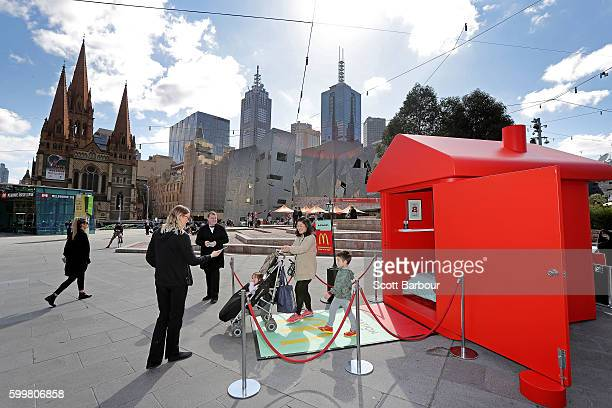 People visit McDonalds Monopoly Hotel at Federation Square on September 7 2016 in Melbourne Australia Built to celebrate the return of the Monopoly...