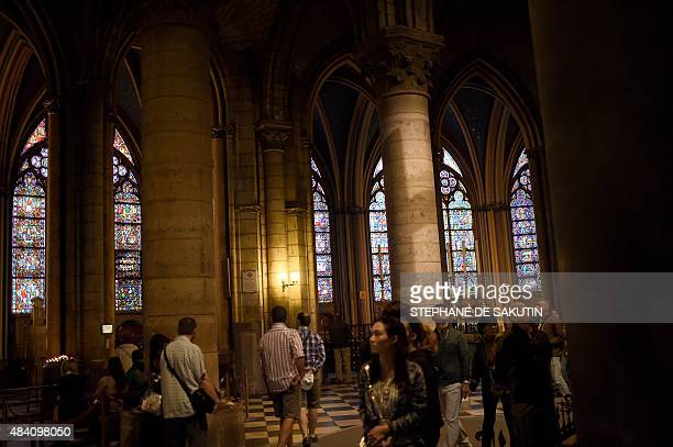 People visit NotreDame de Paris Cathedral on August 15 2015 during the feast of the Assumption in Paris For Christian believers Assumption celebrates...