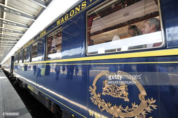 People visit on April 26 the legendary Orient Express train at the Gare de l'Est railway station in Paris as France's stateowned rail company SNCF...