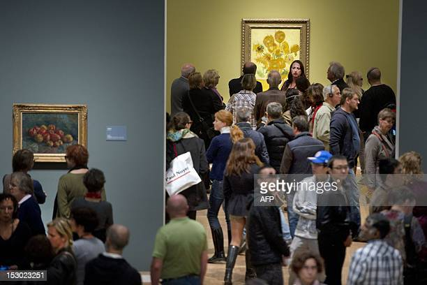 People visit on September 29 2012 the temporary exhibition of paintings of Vincent van Gogh in the Hermitage in Amsterdam as 75 paintings of Van Gogh...