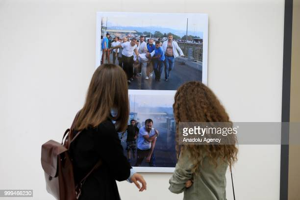 People visit photography exhibition, organized with the photographs from Turkey's Anadolu Agency about the July 15th failed coup attempt in Turkey,...