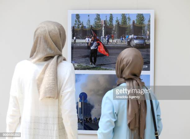 People visit photography exhibition organized with the photographs from Turkey's Anadolu Agency about the July 15th failed coup attempt in Turkey...