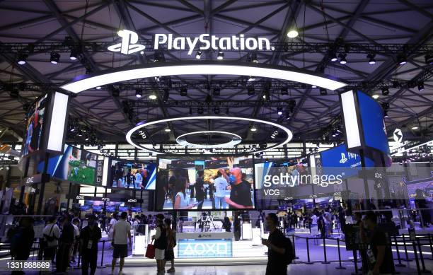 People visit PlayStation stand during the 19th China Digital Entertainment Expo & Conference at Shanghai New International Expo Centre on July 30,...