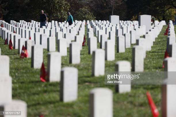 People visit Section 60 at Arlington National Cemetery on Veterans Day November 11 2019 in Arlington Virginia Americans observed Veterans Day to...