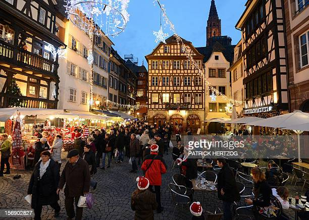 People visit Strasbourg's Christmas market one of the largest and one of the eldest French Christmas markets on November 24 2012 in Strasbourg...