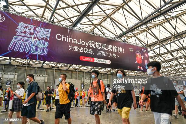 People visit the 19th China Digital Entertainment Expo & Conference is held at Shanghai New International Expo Centre on July 30, 2021 in Shanghai,...