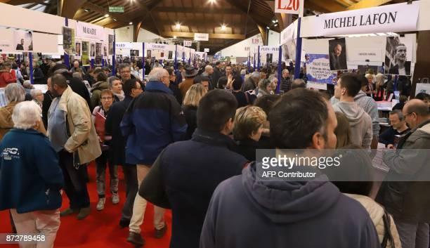 People visit the 36th edition of the 'Foire du Livre de Brive' book fair on November 11 2017 in BrivelaGaillarde southwestern France / AFP PHOTO /...